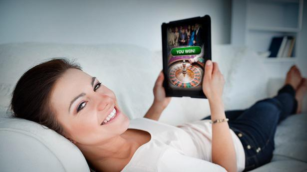 US woman playing online casino on tablet