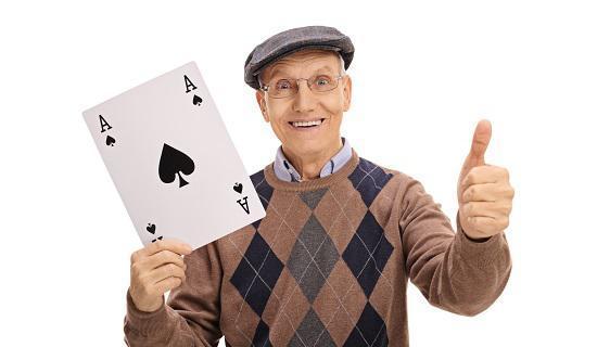 Senior playing casino cards