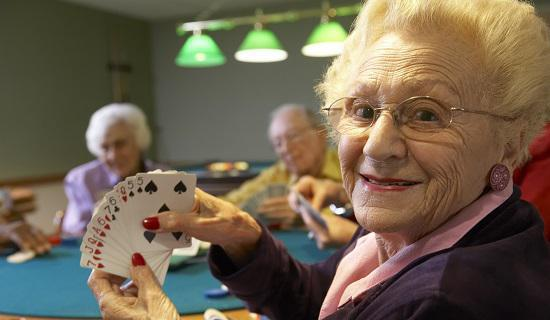 senior adult playing cards in casino