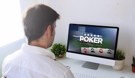 man playing online video poker
